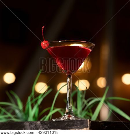 Red Alcoholic Shot. Cocktail Glass Of Drink Backlit On Blurred Background. Festive Event. Nightlife