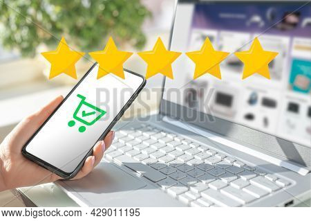Woman Hands Evaluate Product Purchased Online. Rating To The Seller. Five Star Rating. Rise On Incre