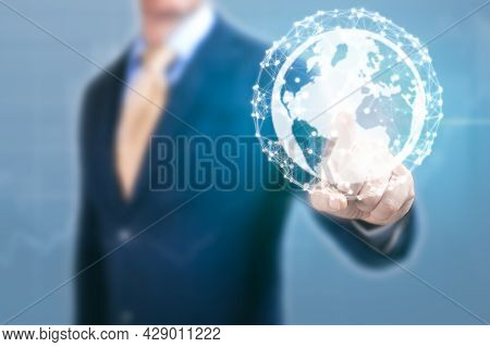 Businessman Point At Earth Globe Hologram. Man Hand With Earth, Concept Of Global Network Communicat
