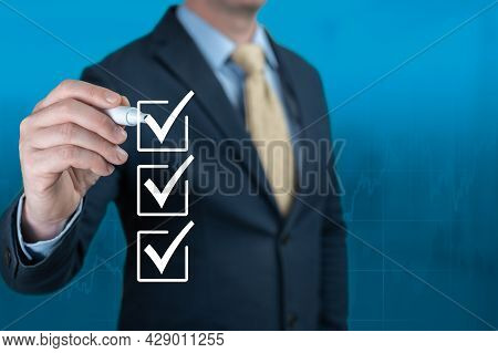 Businessman Hand Checking The Checklist Boxes On Blue Background. Hand Choosing One Of Three Options