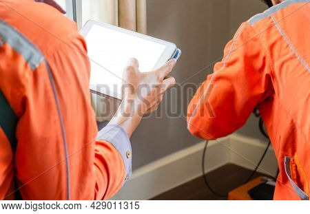 Internet Technician Man Checking Speedtest Upload And Download With Tablet, Technicians Team Install