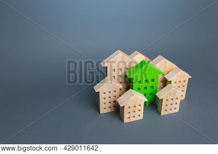 The Green Building Stands Out Among The Houses. Search For The Best Option. Ideal Property To Buy. N