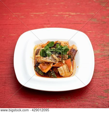 Exotic Oriental Dish With Crab Meat. Plate Of Pan-asian Food On Pink Wooden Background. Soft Focus.