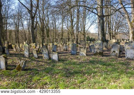 Historic Jewish Graveyard At Early Spring Time Near Berlichingen In Hohenlohe, A Area In Southern Ge