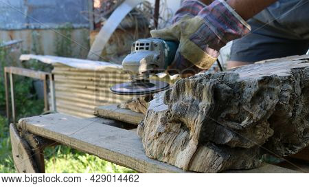 Grinder Processing A Piece Of Solid Wood In The Open Air, Woodworking Process With An Angle Grinder,