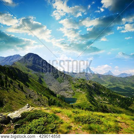 View on the mountain lake Lago di Chamole, Aosta valley, Italy. Summer landscape in the Alps.