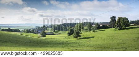 Rural Countryside Landscape With Green Meadows And Village In French Ardennes Near Charleville Under