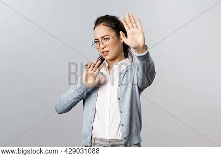 People, Emotions And Lifestyle Concept. Portrait Of Displeased And Disgusted Asian Woman Defending H
