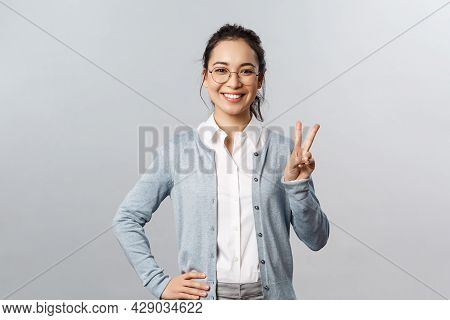 People, Emotions And Lifestyle Concept. Upbeat Optimistic Asian Woman In Glasses, School Teacher Or