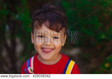A Large Portrait Of A Cute Funny Boy With A Slugged Tongue. The Child Shows A Speech Therapy Exercis