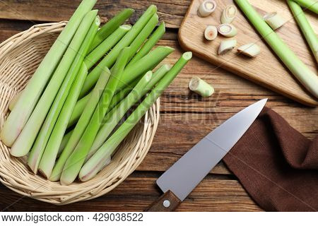 Fresh Lemongrass, Knife And Cutting Board On Wooden Table, Flat Lay