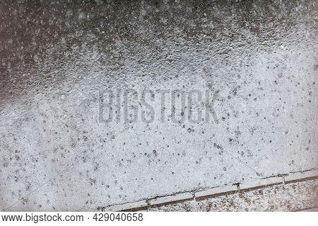 Abstract View Of Raindrops Falls On Street Sidewalk. Rain Drops