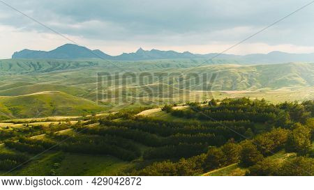 Top View Of Beautiful Green Mountains And Hills In Cloudy Weather With Sun. Shot. Mountain Landscape