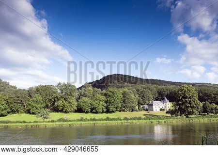 Large Mansion And Forest Near River Maas In Countryside Of French Ardennes In Tyhe North Of France