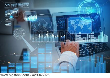 Businessman Working In Front Of Laptop, Blue Hologram Glowing Digital Information Security Interface