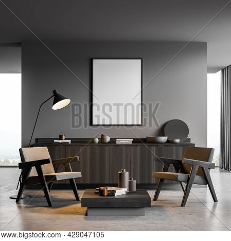 Vertical Banner In The Dark Grey Interior Of The Seating Area With Partition Wall, Two Armchairs, Co