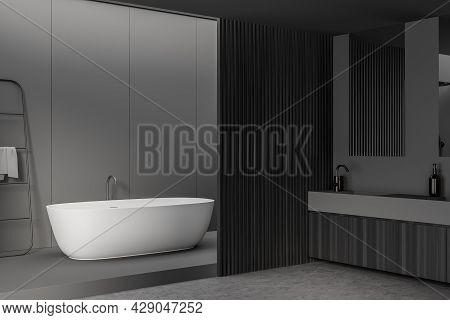 Grey Bathroom Interior With Dark Panel Partition, Wooden Vanity, Mirror And Concrete Floor. Oval Cer