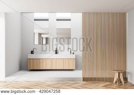 Vanity With Two Sinks, Trendy Faucets And Two Vertical Mirrors Above In The Area With Wooden Partiti
