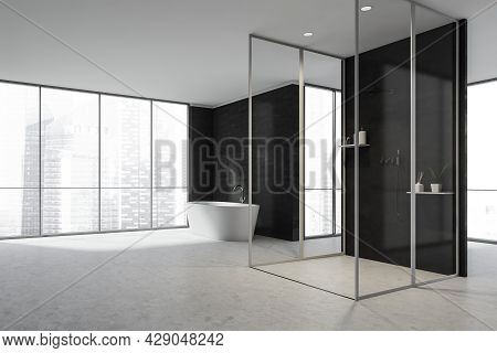 Black And White Interior Of Panoramic Bathroom Space With Corner Of Glass Cabin Near The Black Parti