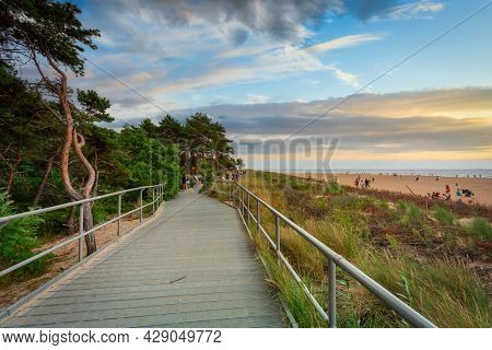 Hel, Poland - July 29, 2021: Promenade to the beach in Hel at the Baltic Sea, Poland