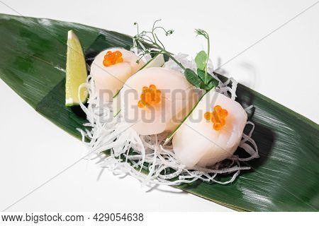 Scallop Sashimi On White Background. Traditional Japanese Food. Raw Scallop Served With Red Salmon C