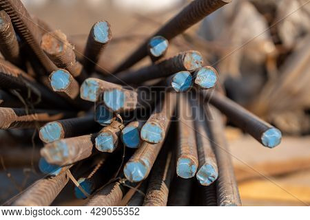 Reinforced Steel Bars On Background Of Construction Site With Copy Space. Metal Base Of Reinforced C