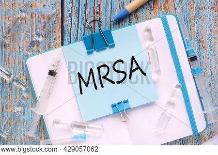 Mrsa Methicillin-resistant Staphylococcus Aureus. The Sticker Is Attached To The Notebook With A Cle