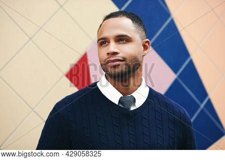 Outdoor Portrait Of Handsome African American Man, Wearing Blue Pullover