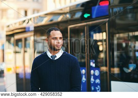 Urban Portrait Of Handsoma African American Man, Posing Outside Wearing Blue Pullover