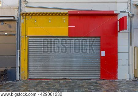 Yellow And Red Dual Business Shop In Cannes France