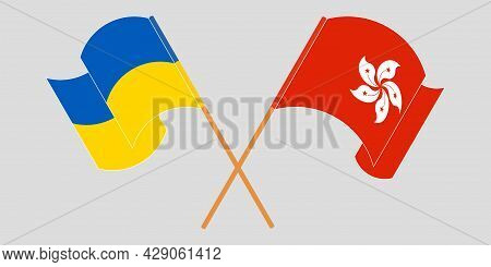 Crossed And Waving Flags Of The Ukraine And Hong Kong