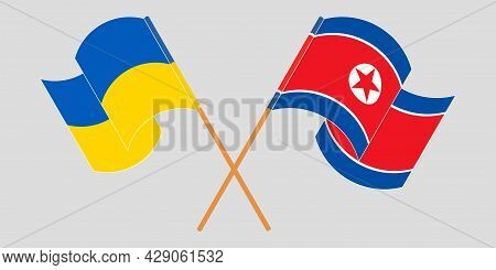 Crossed And Waving Flags Of The Ukraine And North Korea