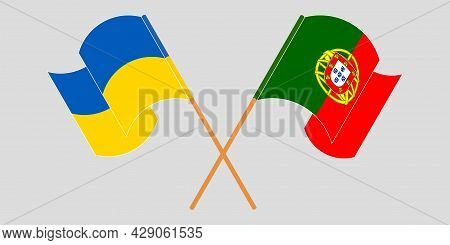 Crossed And Waving Flags Of Ukraine And Portugal.