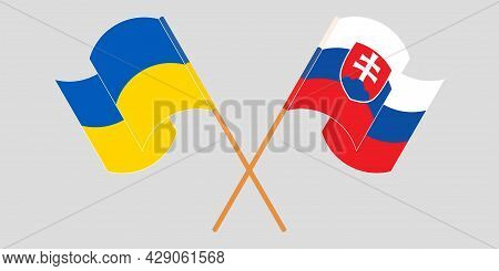 Crossed And Waving Flags Of Ukraine And Slovakia