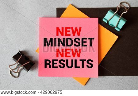 New Mindset New Results Written On A Yellow Sticky Note Pinned On A Bulletin Board