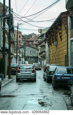 Prishtina, Kosovo - September 13, 2009: Cars Chaotically Parked In Narrow Street Of Dowtown Prishtin