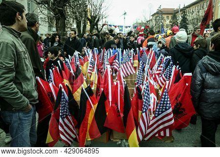 Prishtina, Kosovo - February 17, 2010: Flags Of Kosovo Waiving Next To Usa American And German And A