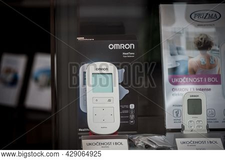Belgrade, Serbia - May 29, 2021: Omron Logo On A Heattens, A Tens Pain Relief Machine For Sale In A