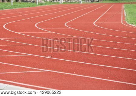 Selective Blur On The Curve On A Running Track, An Athletics Field Used For Athletism Competition, L