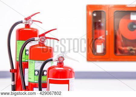 Fire Extinguisher, Close-up Red Fire Extinguishers Tank With Fire Hose Cabinet In The Building Conce