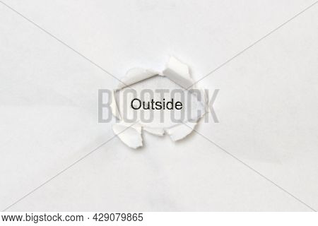 Word Outside On White Isolated Background, The Inscription Through The Wound Hole In Paper. Concept