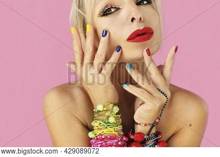 Multicolored Short Manicure And Makeup On A Girl With Beaded Jewelry.