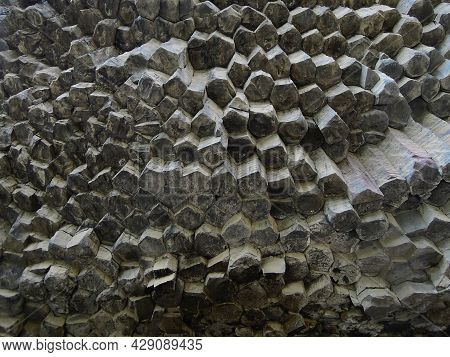 Close Up View From Bottom Upwards On The Textures Of The Basalt Columns Of The Gorge Garni, Known As