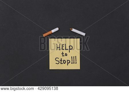 Memo Piece Of Paper With The Slogan Help To Stop And Broken Cigarette On Black Background. Quit Smok