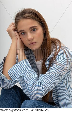 Portrait Of Young Attractive Caucasian Woman With Long Brown Hair In T-shirt And Blue Shirt Isolated