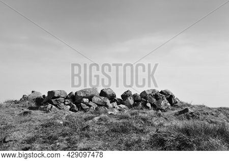 The Exposed Stones At The Top Of A Cairn Known As The Millers Grave On Midgley Moor In Calderdale We