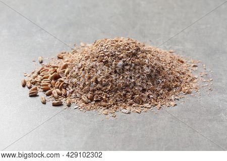 Pile Of Wheat Bran On Grey Table