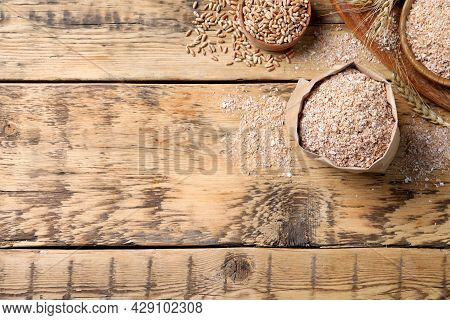 Wheat Bran On Wooden Table, Flat Lay. Space For Text