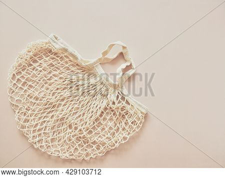 Cotton Shopper And Reusable Mesh Shopping Bags On Neutral Beige Background. Eco Friendly Mesh Shoppe
