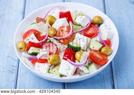 Greek Salad. Traditional Greek Dish. Healthy Vegetarian Food. Fresh Vegetables And Feta Cheese In A